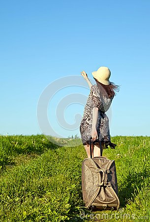 Beautiful girl travelling with a suitcase
