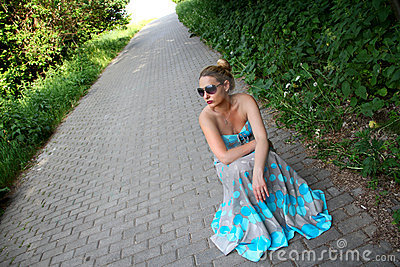 Beautiful girl in a turquoise dress
