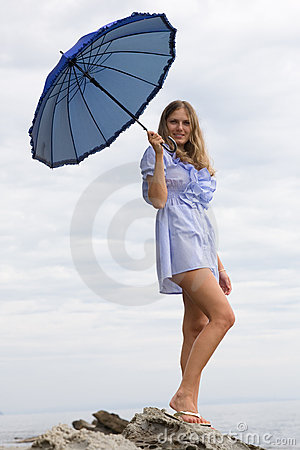 Beautiful girl with an umbrella