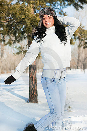 Beautiful girl on a walk in a winter park,