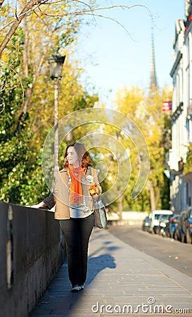 Beautiful girl walking in Paris
