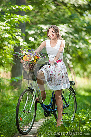 Free Beautiful Girl Wearing A Nice White Dress Having Fun In Park With Bicycle. Healthy Outdoor Lifestyle Concept. Vintage Scenery Stock Photos - 43778033