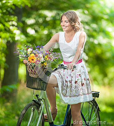 Free Beautiful Girl Wearing A Nice White Dress Having Fun In Park With Bicycle. Healthy Outdoor Lifestyle Concept. Vintage Scenery Royalty Free Stock Image - 43778036