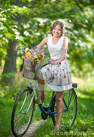 Free Beautiful Girl Wearing A Nice White Dress Having Fun In Park With Bicycle. Healthy Outdoor Lifestyle Concept. Vintage Scenery Royalty Free Stock Photography - 43778247