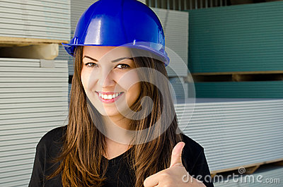Beautiful girl wearing a blue safety helmet