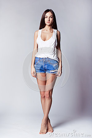 Free Beautiful Girl Wearing Denim Shorts And Shirt Stock Photography - 50392602