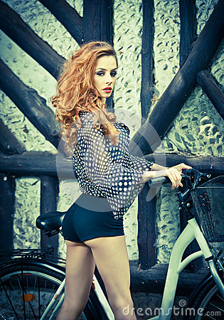 Free Beautiful Girl Wearing Ultramarine Blouse And Black Sexy Shorts In Park With Bicycle. Pretty Red Hair Woman Posing Near Her Bike Royalty Free Stock Images - 44726869