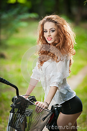 Free Beautiful Girl Wearing White Lace Blouse And Black Sexy Shorts Having Fun In Park With Bicycle. Pretty Red Hair Woman Posing Royalty Free Stock Photography - 44726847