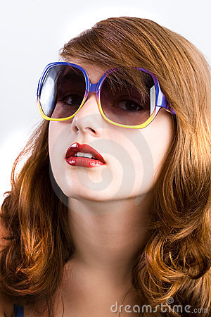 Beautiful girl wears sunglasses