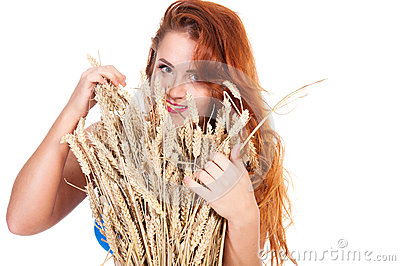 The beautiful girl with wheat ears isolated