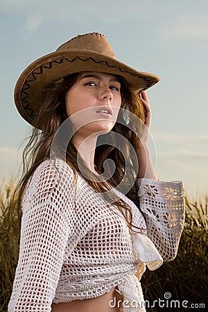 Beautiful girl in wheat field on sunset