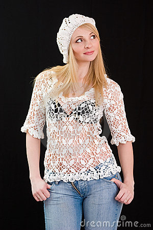 Beautiful girl in white beret and knitted jacket.