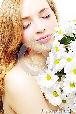 Beautiful girl with white chrysanthemum