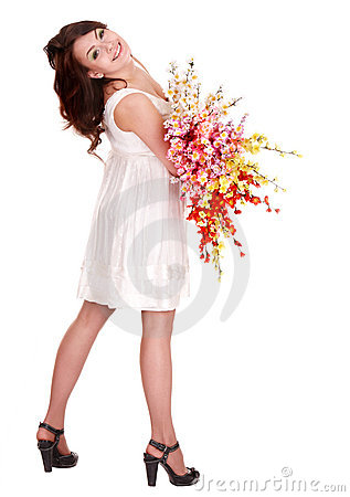 Beautiful girl in white dress with spring flower.