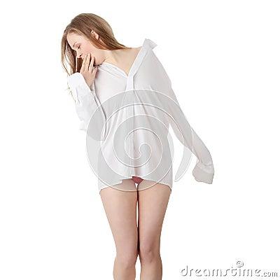 The beautiful girl in a white men shirt