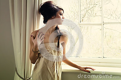 Beautiful girl by window