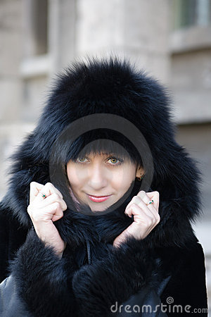 Beautiful girl in a winter clothing against