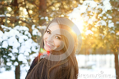 Beautiful girl in winter forest