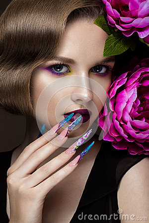 Free Beautiful Girl With Colorful Make-up, Flowers, Retro Hairstyle And Long Nails. Manicure Design. The Beauty Of The Face. Stock Photos - 73105553