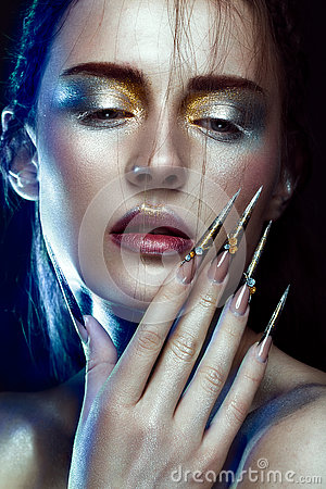Free Beautiful Girl With Creative Golden And Silver Glitter Make-up, Long Nails Art. Beauty Face. Stock Photography - 80182012