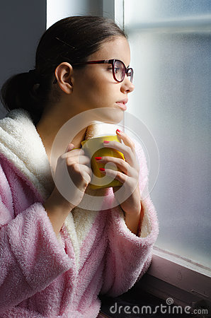 Free Beautiful Girl With Glasses Drinking Morning Coffee In Front Of Window Stock Images - 68597574