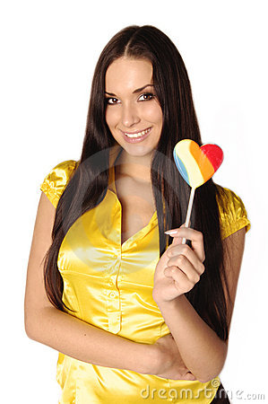 Free Beautiful Girl With Heart Shaped Colourful Candy Royalty Free Stock Image - 7134746