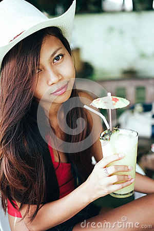 Free Beautiful Girl With The Hat, Drinking Fresh And Refreshing Pineapple Juice, Summer Holiday Vacation Stock Images - 91813584