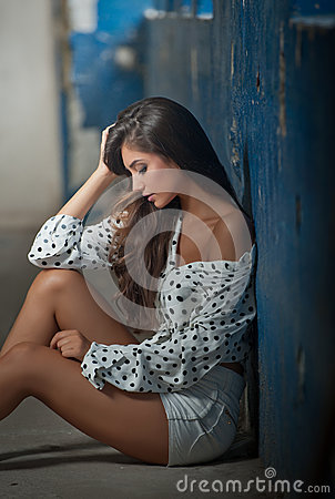 Free Beautiful Girl With Unbuttoned Shirt Posing, Old Wall With Peeling Blue Paint On Background. Pretty Brunette Sitting On The Floor. Stock Images - 75407834