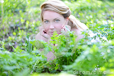 Beautiful girl in wood amongst green sheet