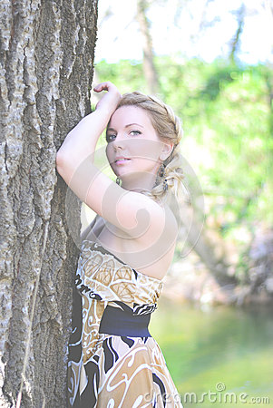 Beautiful girl in wood by summer