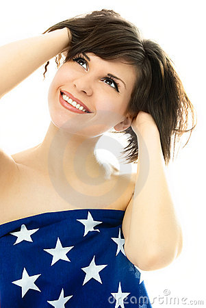 Beautiful girl wrapped into an American flag