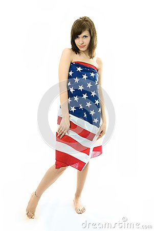 Beautiful girl wrapped into the American flag