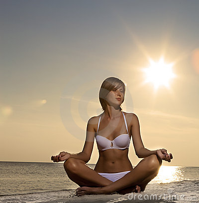 beautiful-girl-yoga-on-the-beach-at-sunset-thumb15660988