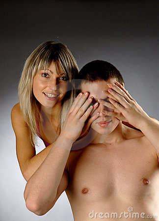 Beautiful girls covers eyes of half naked man