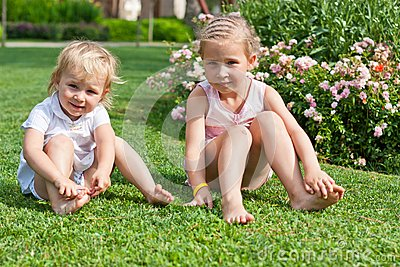 Beautiful girls sitting on the green grass