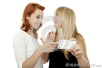 Beautiful girls talking about something at phone