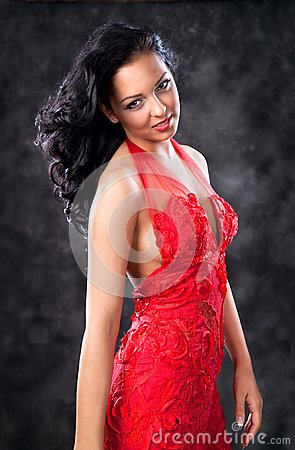 Beautiful glamorous woman with red dress