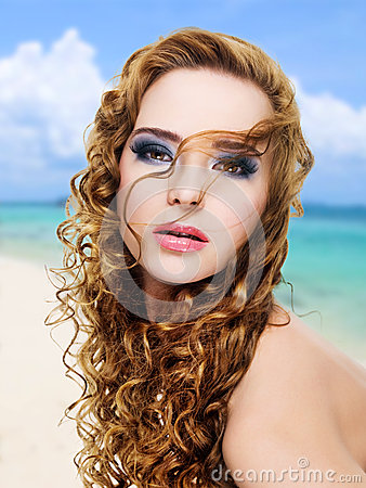 Beautiful glamour  woman with  long curly hairs