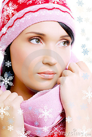 Beautiful glamour woman in the red warm winter hat