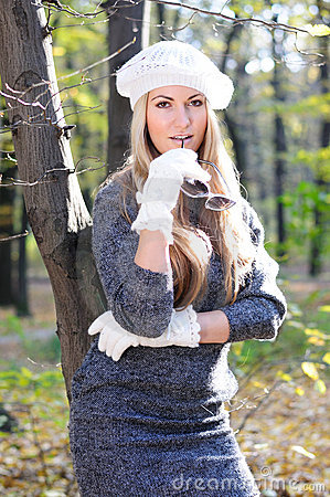 Beautiful glamour women in white cap and gloves