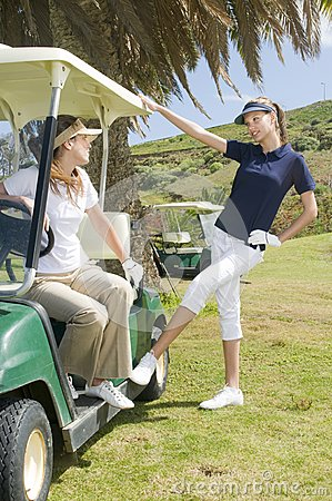 Beautiful golf players talking during a golf play