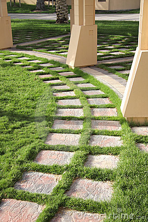 Beautiful grass decorated path in a garden