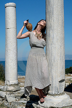 Beautiful Greek young girl holding a vessel