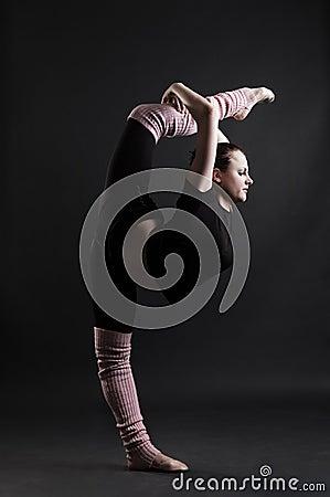 Beautiful gymnast doing splits