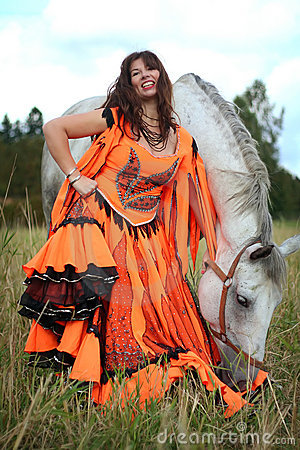 Beautiful gypsy dancer with a horse