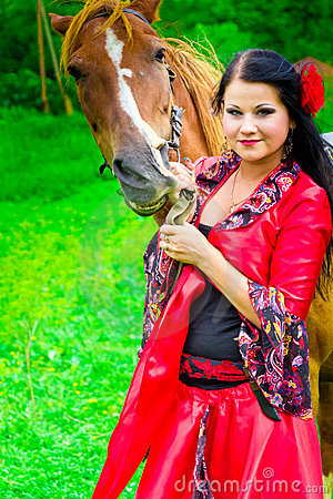 Beautiful gypsy girl with a horse