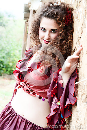 Beautiful gypsy girl in red dress