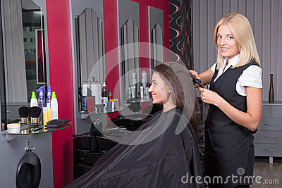 Beautiful hairdresser working in beauty salon