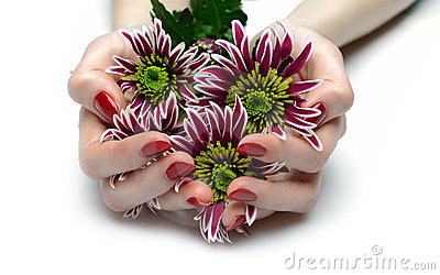 Beautiful hand with red manicure and flowers