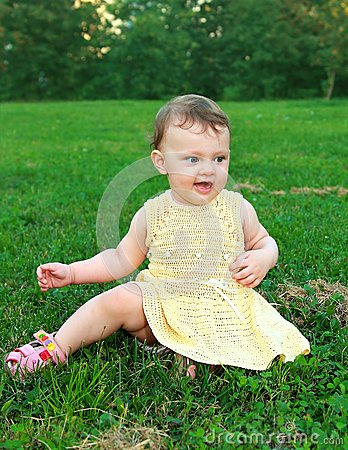 Beautiful happy baby girl sitting